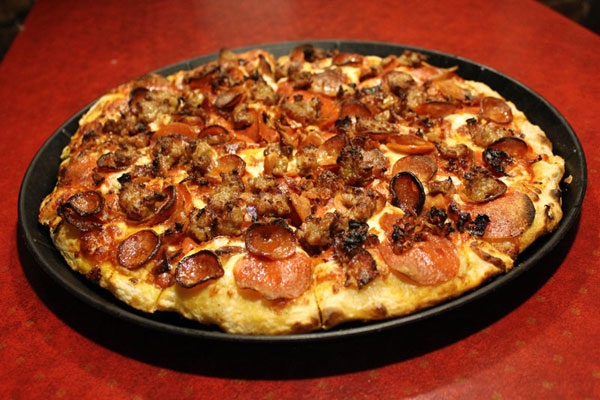 COWBOY PIZZA - JUST $10 LARGE. Buy a family size for just $3 more